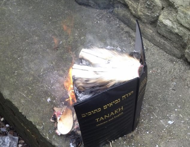 The image Shneur Odze tweeted, of him burning the book (Via The Daily Mail)