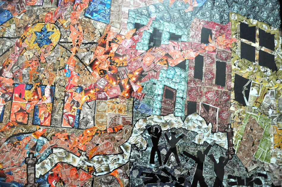 Using canceled postage stamps, students at the Foxboro Regional Charter School in Massachusetts created a 'Kristallnacht' mural depicting a synagogue on fire and violence on the streets (Courtesy)