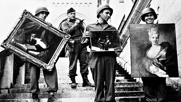 Soldiers pose with Nazi-looted art
