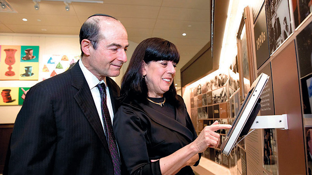 Richard and Ellen Gertler view a display at the new Hillel House.