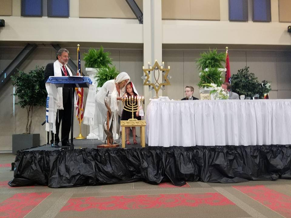 Lighting candles at the Cross Life Church seder in El Dorado, Arkansas. (Courtesy)