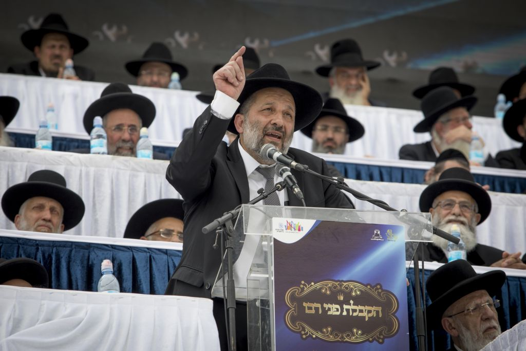 Interior Affairs Minister and head of the Shas party Aryeh Deri speaks at El Hama'ayan Passover conference at Teddy Stadium in Jerusalem on April 13, 2017. (Yonatan Sindel/Flash90)