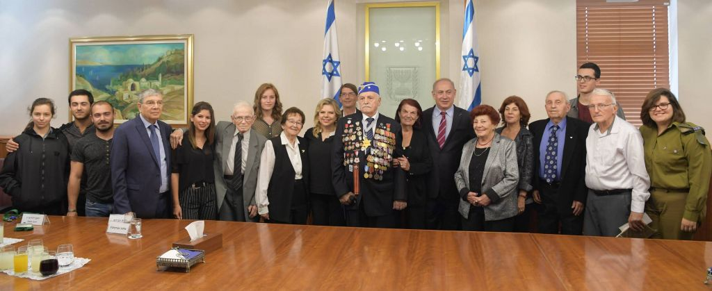 Prime Minister Benjamin Netanyahu and his wife Sara meet with the torch lighters of this year's State ceremony for the Israeli Holocaust Memorial Day, at the Prime Minister's office in Jerusalem, on April 20, 2017. (Amos Ben Gershom/GPO)