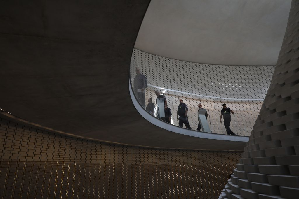 People walk through the new National Memorial Hall at the entrance to the military cemetery on Mount Herzl during its official opening ceremony, in Jerusalem, April 30, 2017. (Yonatan Sindel/Flash90)