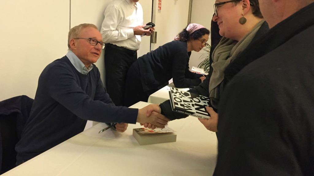 Author David Grossman signs copies of 'A Horse Walked into a Bar' at a April 2, 2017, Times of Israel event in Jerusalem. (Amanda Borschel-Dan/Times of Israel)