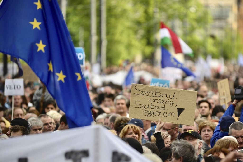 Demonstrators hold a placard reading 'Free country, free university!' as they protest against the efforts to close Central European University, as part of Prime Minister Viktor Orban's plan to transform Hungary into an 'illiberal state' in Budapest, Hungary, Sunday, April 9, 2017. (Janos Marjai/MTI via AP)