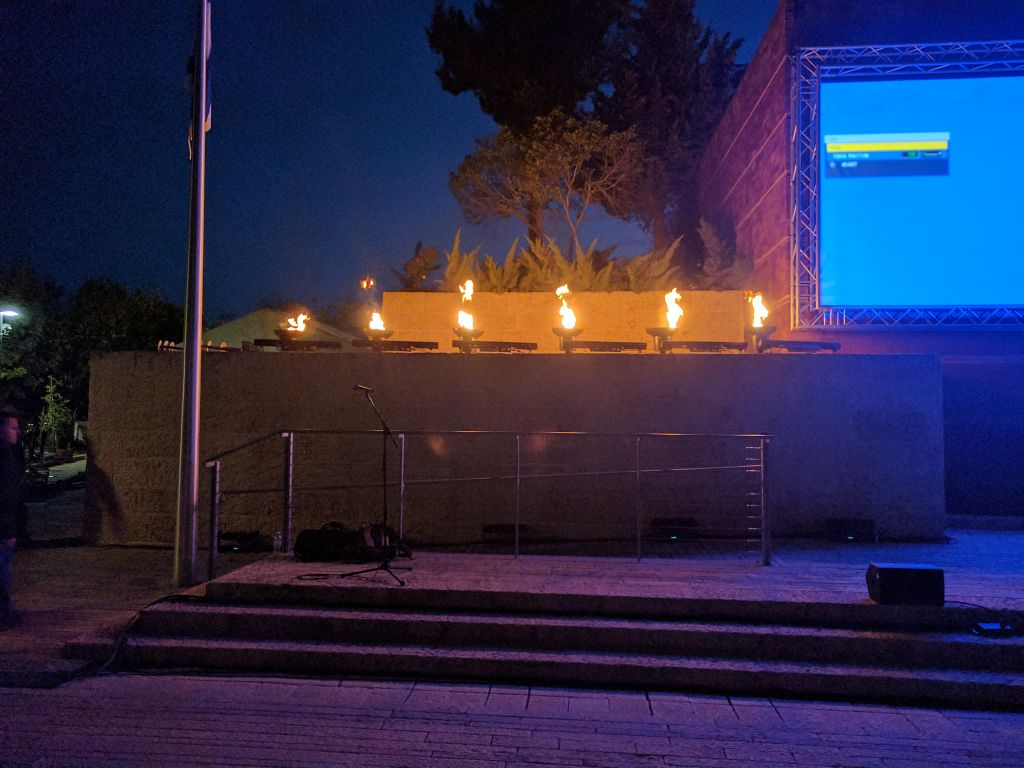 The torch lights burn at the April 20, 2017 Yad Vashem dress rehearsal for Holocaust Remembrance Day. (Yaakov Schwartz/ Times of Israel)