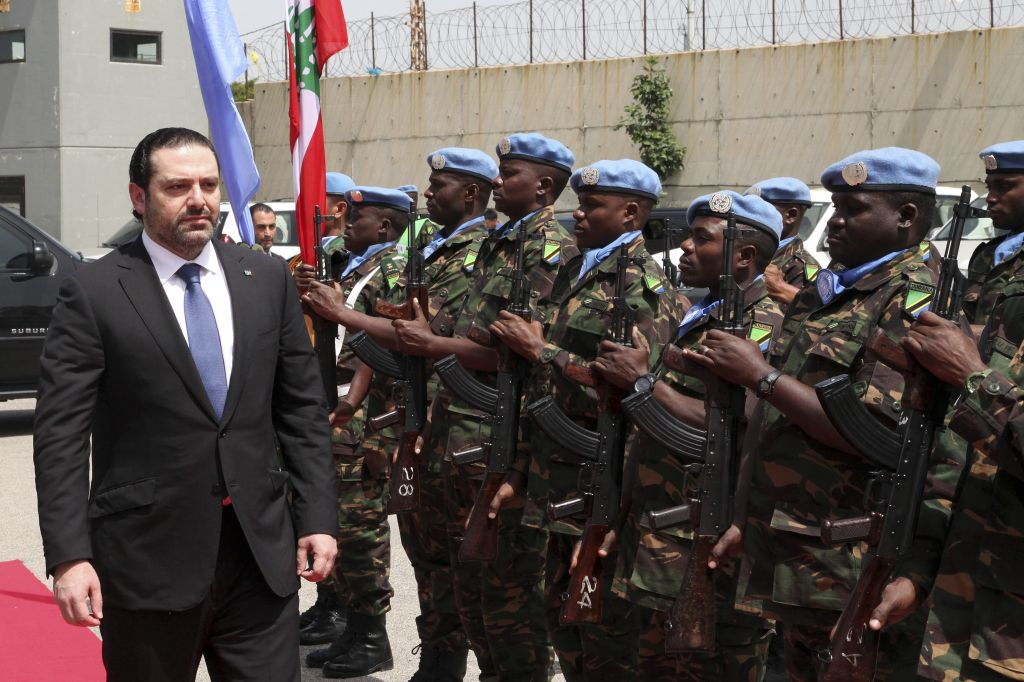 Lebanese Prime Minister Saad Hariri reviews an honor guard of United Nations peacekeepers, upon his arrival at their headquarters, at the coastal border town of Naqura, south Lebanon, Friday, April 21, 2017. (Dalati Nohra via AP)