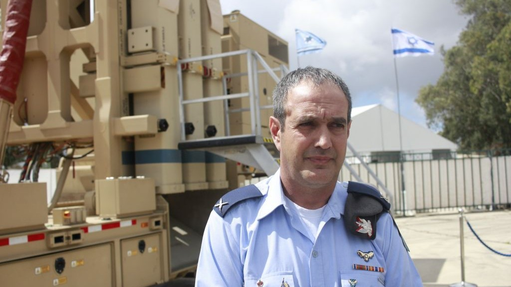 IDF Brig. Gen. Tzvika Haimovitch stands in front of the David's Sling missile defense system at the Hatzor Air Base in central Israel on April 2, 2017. (Judah Ari Gross/Times of Israel)