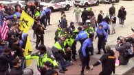 Scuffle between security and Jewish Defence League activists, who assaulted a Palestinian man