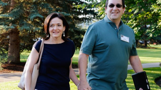 Dave Goldberg, right, with wife Sheryl Sandberg in Sun Valley, Idaho, July 10, 2013. JTA