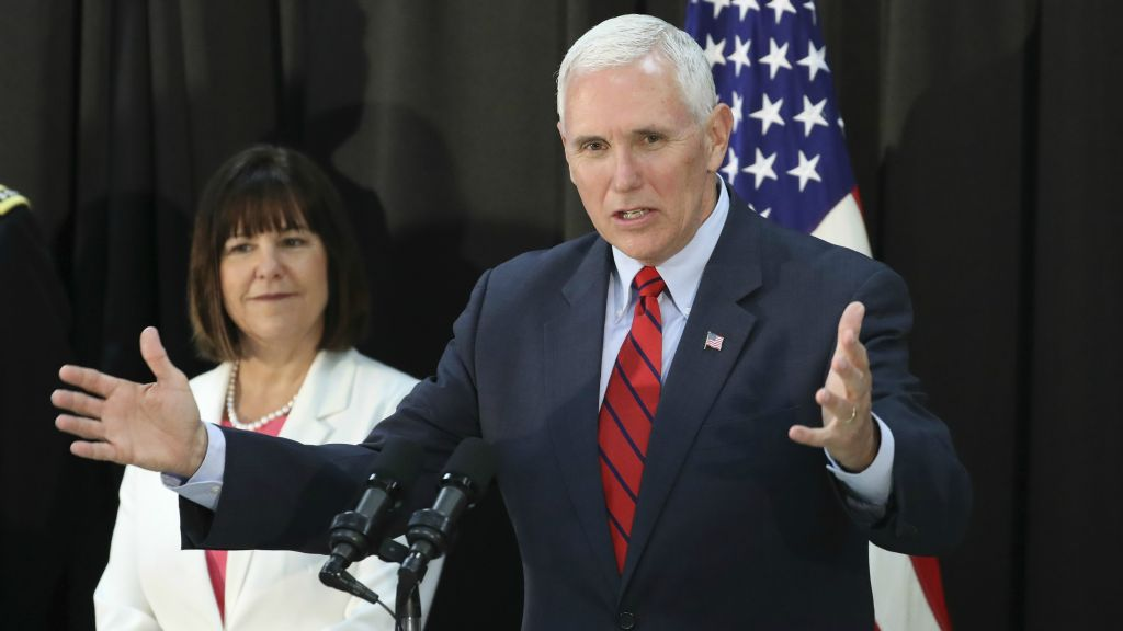 US Vice President Mike Pence speaks as his wife Karen Pence listens during a dinner with soldiers and family members after Easter Sunday church services at a military base in Seoul South Korea Sunday