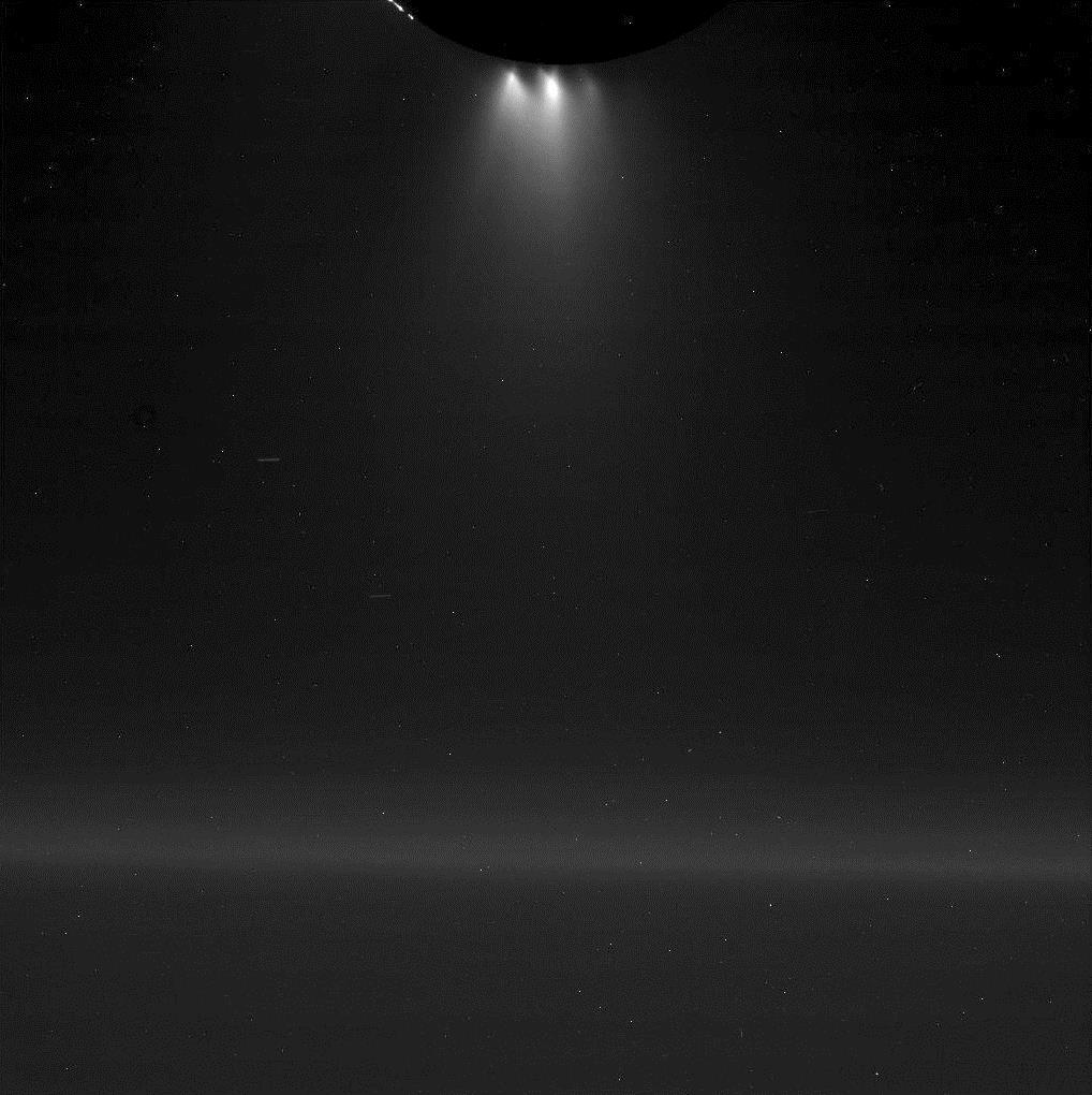 This image provided by NASA shows plumes of gas and dust-sized icy particles, top, emerging from the southern region of Saturn's moon Enceladus as the Cassini spacecraft made a close flyby of the icy moon, Oct. 28, 2015. (NASA/JPL-Caltech/Space Science Institute via AP)