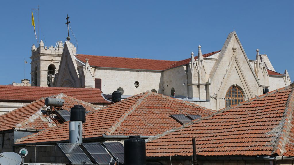 The roofs of houses in the Christian Quarter, with a view of the Jerusalem Patriarchate. (Shmuel Bar-Am)