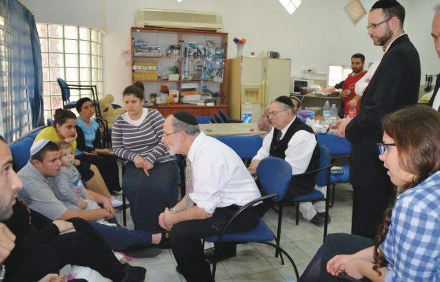 On a trip to Israel, Rabbi Goldin is at a shiva for a murdered teenager.