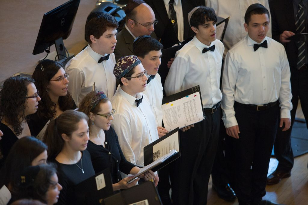 Students perform songs in commemoration of the Holocaust at Boston's Faneuil Hall, April 23, 2017 (Elan Kawesch/The Times of Israel)