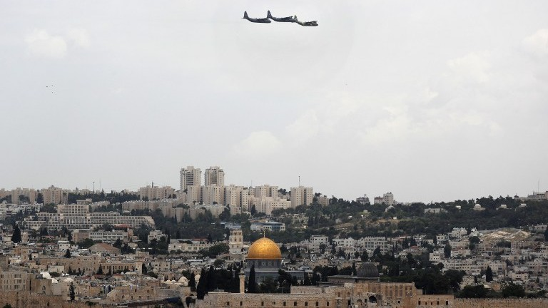 Israeli C-130 transport planes flt over Jerusalem during celebrations marking Israel's 69th Independence Day on May 2, 2017. (AFP Photo/Thomas Coex)