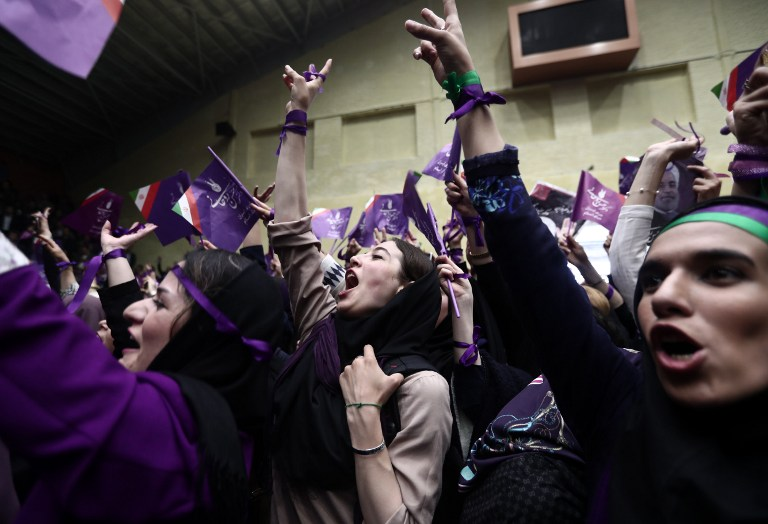 Supporters of Iranian President and candidate in the upcoming presidential elections Hassan Rouhani attend a campaign rally in the northwestern city of Ardabil