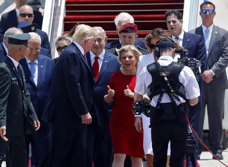 US President Donald Trump and First Lady Melania Trump are welcomed by Israeli Prime Minister Benjamin Netanyahu, and his wife Sara, upon Trump's arrival at Ben Gurion International Airport in Tel Aviv on May 22, 2017, as part of his first trip overseas. (AFP PHOTO / Jack GUEZ)