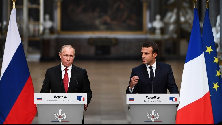 French President Emmanuel Macron (R) gestures as he speaks during a joint press conference with Russian President Vladimir Putin (L) following their meeting at the Versailles Palace, near Paris, on May 29, 2017. (AFP Photo/Christophe Archambault)