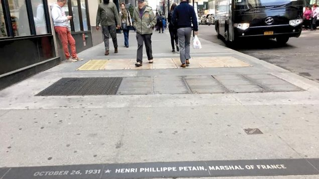 The plaque honoring Philippe Petain, WWI hero and Nazi collaborator, in the Canyon of Heroes has garnered criticism.