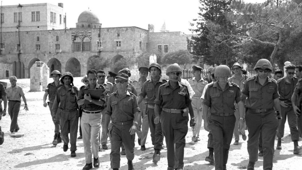 Heroes of '67: From left in foreground, Uzi Narkiss, Moshe Dayan and Yitzchak Rabin walk through Jerusalem, which was reunited during the Six-Day War in June for the first time since the Temple was destroyed. Wikimedia Commons
