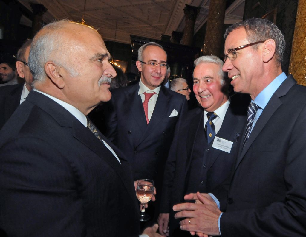 Prince El Hassan bin Talal (left) talking with Israeli Ambassador to the UK Mark Regev (right) Photo credit: John Rifkin