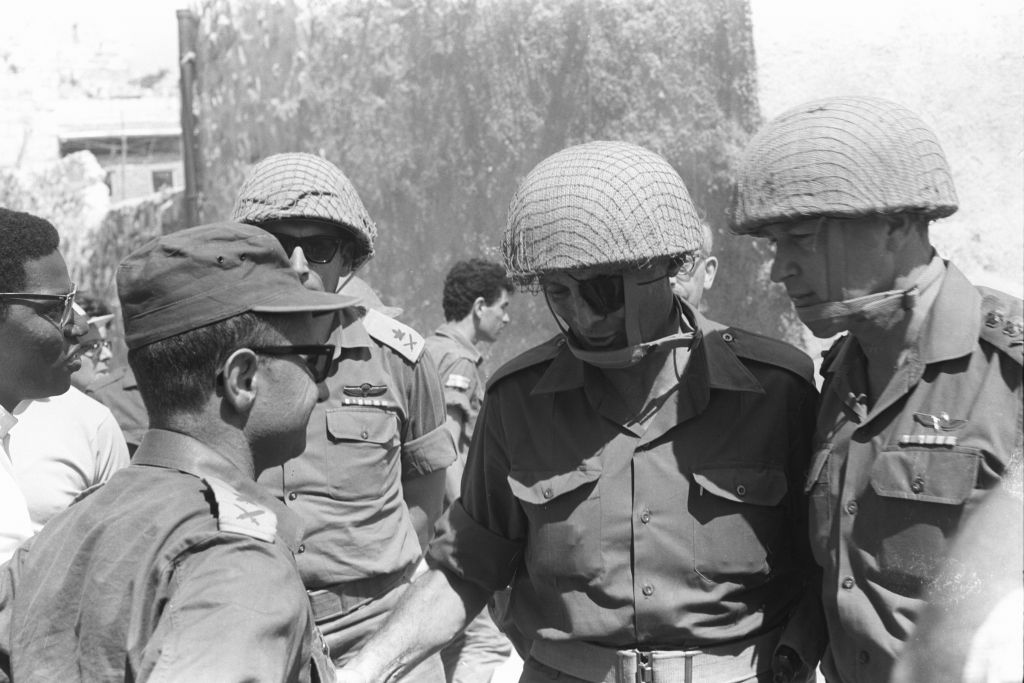 From left, then-Maj. Gen. Uzi Narkis, then-Maj. Gen. Rehavam Zeevi, then-defense minister Moshe Dayan and then-IDF chief of staff Yitzhak Rabin visit the Western Wall in Jerusalem's Old City on June 7, 1967. (Bamahane Magazine/Defense Ministry's IDF Archive)
