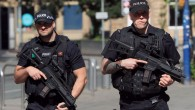 Armed police close to the Manchester Arena, the morning after a suicide bomber killed 22 people, including children, as an explosion tore through fans leaving a pop concert in Manchester. PRESS ASSOCIATION Photo. Picture date: Tuesday May 23, 2017. See PA story POLICE Explosion. Photo credit should read: Danny Lawson/PA Wire