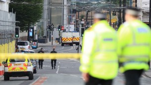 Police close to the Manchester Arena the morning after a suspected terrorist attack at the end of a concert by US star Ariana Grande left 22 dead. PRESS ASSOCIATION Photo. Picture date: Tuesday May 23, 2017. See PA story POLICE Explosion. Photo credit should read: Peter Byrne/PA Wire