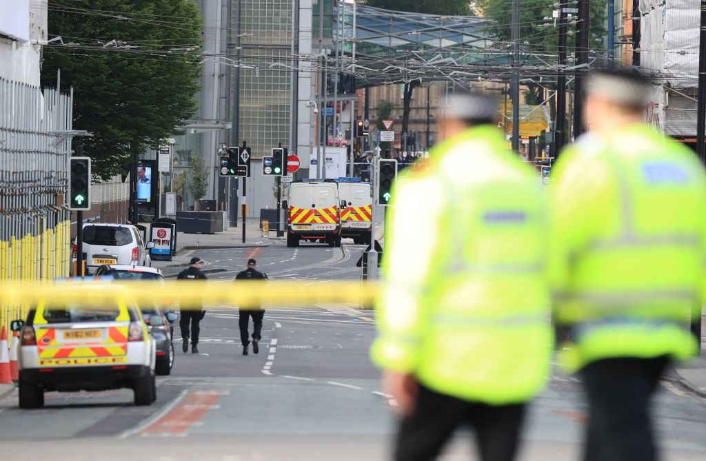 Police close to the Manchester Arena the morning after a suspected terrorist attack at the end of a concert by US star Ariana Grande left 22 dead. Photo credit: Peter Byrne/PA Wire