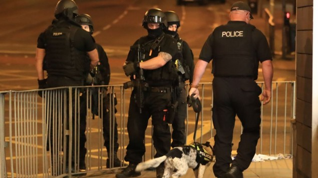 Armed police after a suspected terrorist attack at the Manchester Arena at the end of a concert by US star Ariana Grande left 19 dead.   Photo credit: Peter Byrne/PA Wire