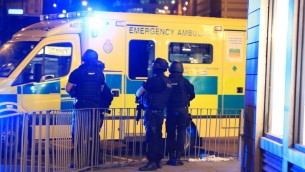 Armed police next to an ambulance after a suspected terrorist attack at the Manchester Arena at the end of a concert by US star Ariana Grande left 19 dead.   Photo credit: Peter Byrne/PA Wire