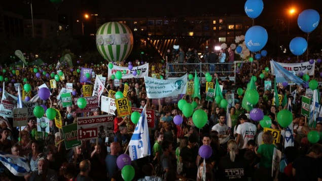 "Israelis take part in a rally in support of establishing a Palestinian state alongside Israel to end the conflict, in Tel Aviv, Israel, Saturday, May 27, 2017. Yellow signs read: ""50 years is enough, peace now. Photo by: Daniel Bar-On-JINIPIX"