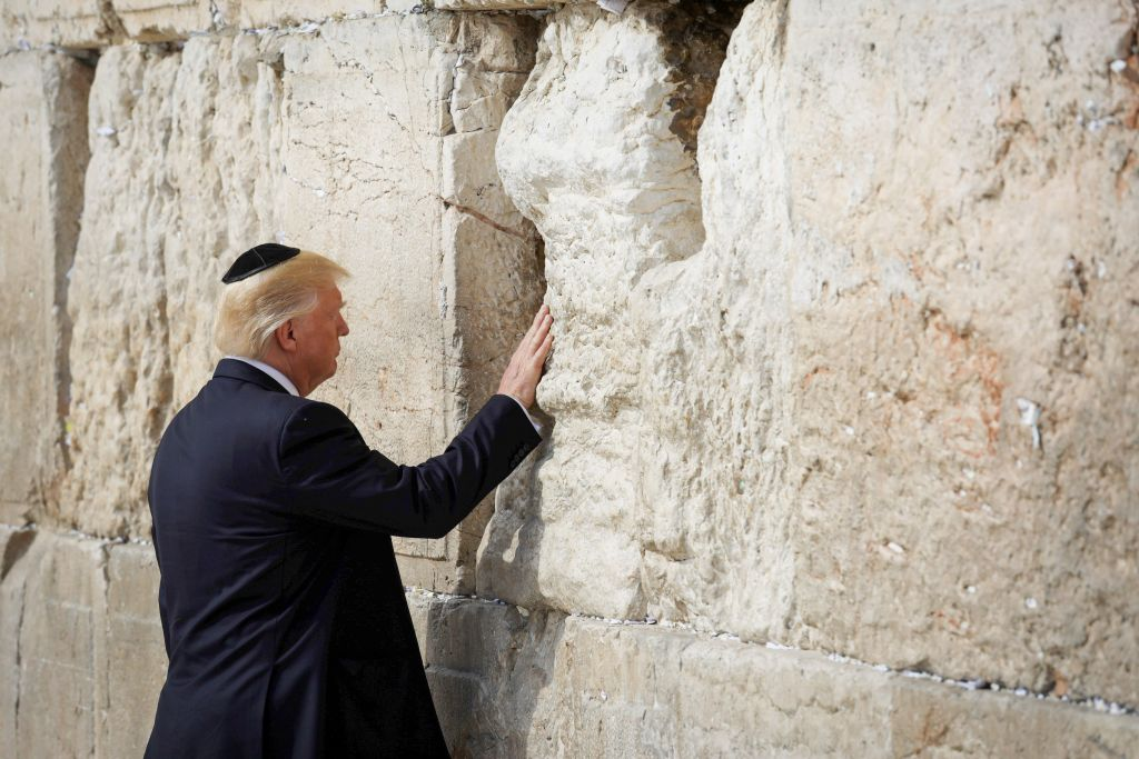 U.S. President Donald Trump places a note in the stones of the Western Wall, Judaism's holiest prayer site, in Jerusalem's Old City  Photo by: Nati Shochat-JINIPIX