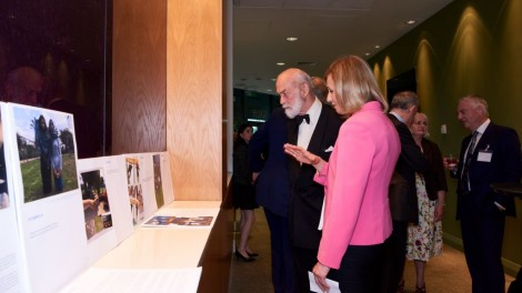 Prince Michael of Kent looking at the art exhibition with Elise Moore-Searson