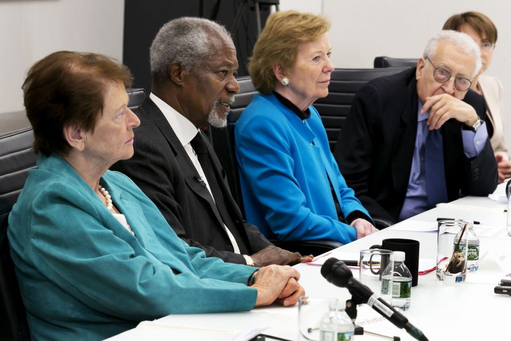 In this Monday, May 8, 2017 photo, former Prime Minister Gro Harlem Brundtland of Norway, left, former UN Secretary-General Kofi Annan, second left, former President Mary Robinson of Ireland, third left, and former Joint Arab League-UN Special Representative for Syria Lakhdar Brahimi attend a meeting at The Associated Press headquarters, in New York. (AP Photo/Richard Drew)