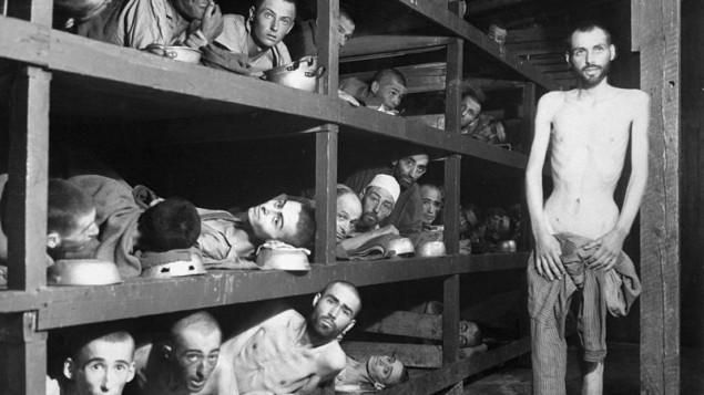 Buchenwald, photo taken April 16, 1945, five days after liberation of the camp. Wiesel is in the second row from the bottom, seventh from the left, next to the bunk post. .