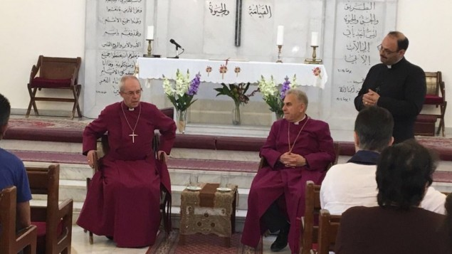 Archbishop with Iraqi Christians in Jordan