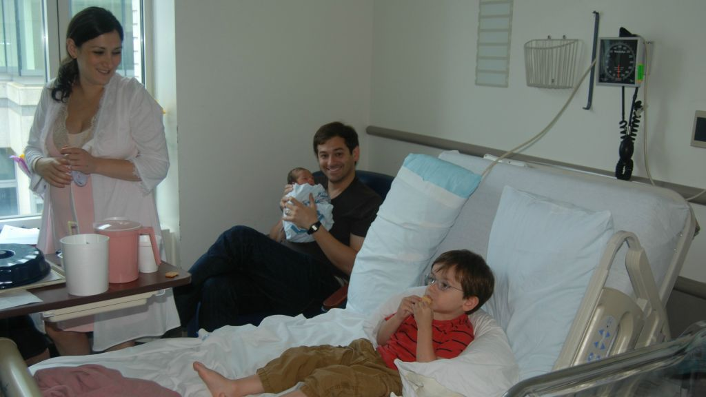 Lauren Smith Brody with her family in the hospital room after the birth of her youngest child. (Courtesy)