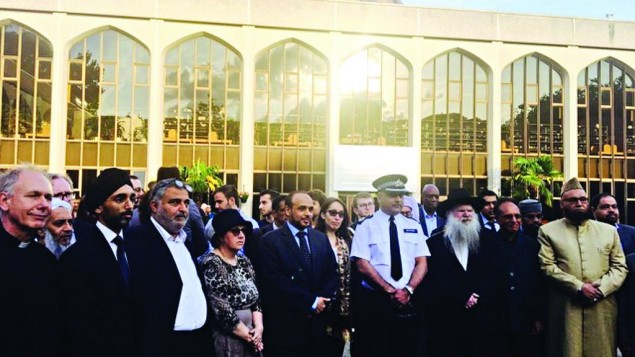 Members of different faiths together at a vigil following a terror attack
