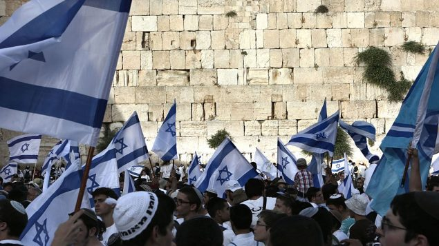 Israelis with national flags gather at the Western Wall on June 5, 2016 in Jerusalem's old city, as they celebrate Jerusalem Day. Getty Images