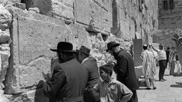 Ultra-orthodox Jews pray 09 June 1967 at the Wailing Wall in Jerusalem after the IDF conquered over Jordan the eastern part of the Holy City. Getty Images