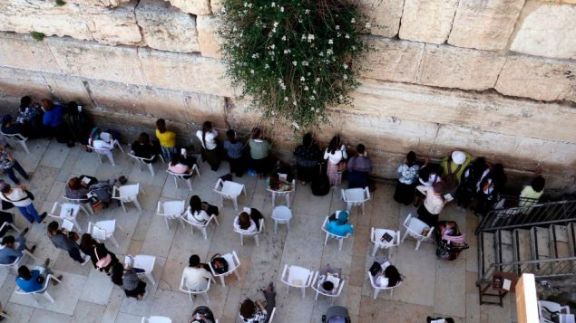 Jewish women pray at the women's section of the Western Wall in the old city of Jerusalem on May 16, 2017. Getty Images