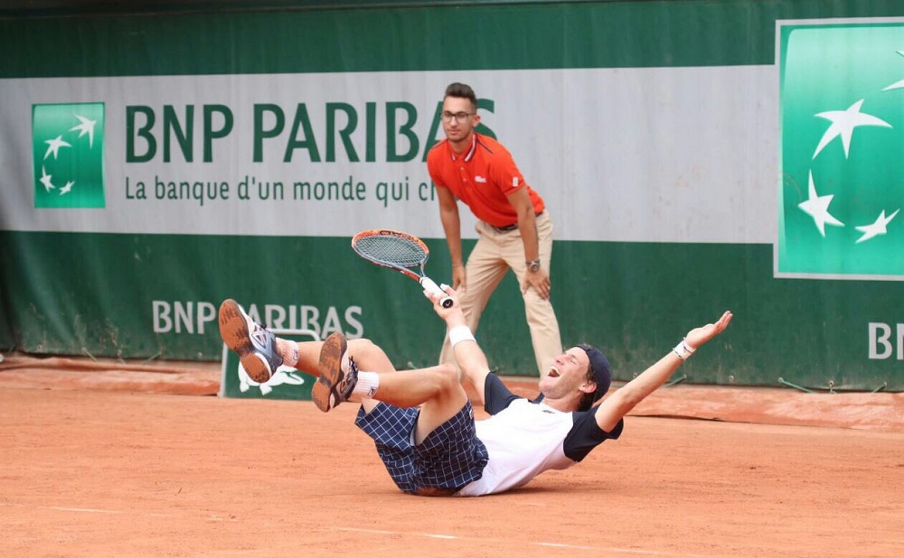 French Open player banned for embracing reporter