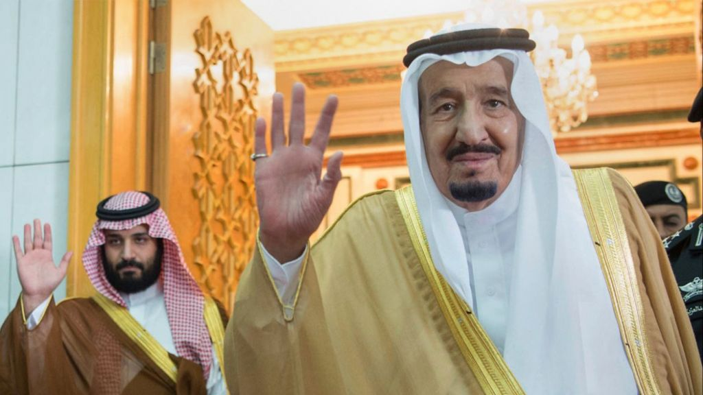 In this April 5, 2017 photo, released by the Saudi Press Agency, SPA, Saudi King Salman, right, and Defense Minister and Deputy Crown Prince Mohammed bin Salman wave as they leave the hall after talks with the British prime minister, in Riyadh, Saudi Arabia. (Saudi Press Agency via AP)