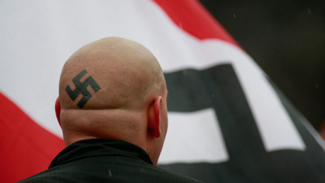 A neo-Nazi demonstrating near the Illinois Holocaust Museum & Education Center in Skokie, Ill. Getty Images
