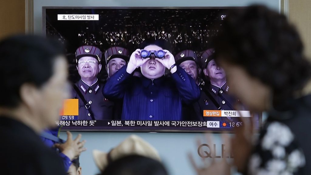A TV news program shows a file image of North Korean leader Kim Jong Un at the Seoul Railway Station in Seoul, South Korea, Sunday, May 14, 2017. (AP Photo/Ahn Young-joon)