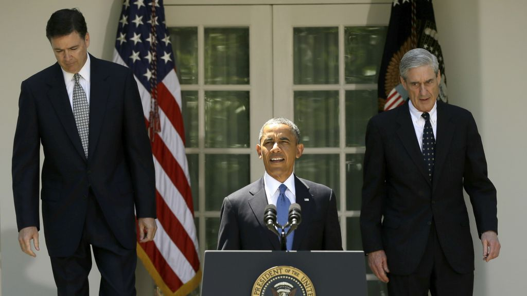 US President Barack Obama, followed by outgoing FBI Director Robert Mueller, right, and his choice to succeed Mueller, James Comey, left, walks towards the podium in the Rose Garden of the White House in Washington on June 21, 2013. (AP Photo/Pablo Martinez Monsivais)