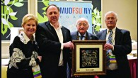 Claims Conference vice president Sandy Cahn, Greg Schneider, Holocaust survivor Roman Kent with his honorary Limmud FSU award, and Chaim Chesler